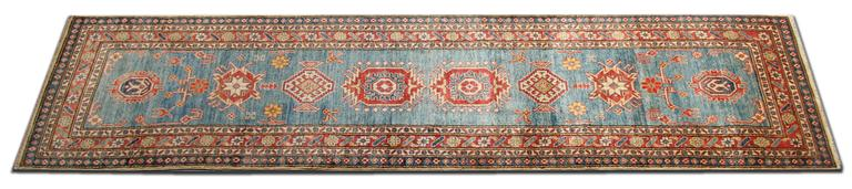 This new traditional handwoven floral rug comes in a striking color combination. This blue rug has bright red, navy, light blue, sea blue, cream and caramel colors. The pattern depicted on this woven rug has been influenced by the Caucasian designs