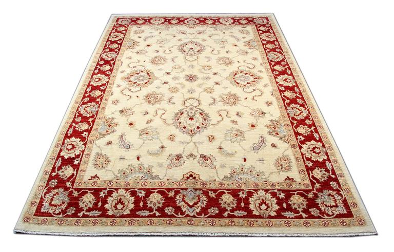 This magnificent gold rug is a Ziegler Sultanabad style woven rug made on our looms by our master weavers in Afghanistan. The carpet rug is handmade with all-natural veg dyes and all handspun wool. The Oriental rugs of Sultanabad are extremely