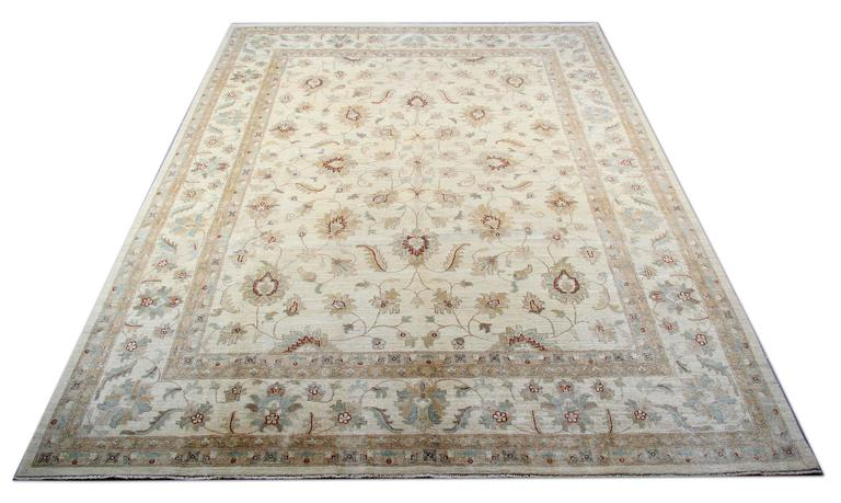 This washable Cream rug is a Ziegler Sultanabad rug made on our looms by our master weavers in Afghanistan. It is handmade Carpet with all natural veg dyes all handspun wool. The large-scale design makes Sultanabad regarded as the most appealing to