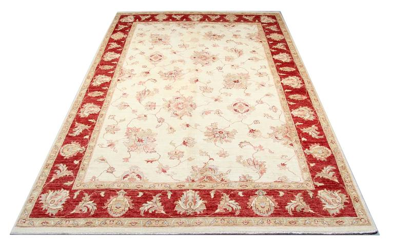 This Ivory white rug with a magnificent red border is a Ziegler Sultanabad woven rug made on our looms by our master weavers in Afghanistan. These handmade rugs are woven with all natural veg dyes and all handspun wool. The large rug scale design