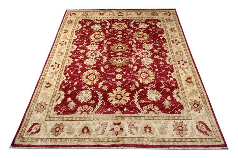 This woven rug is a Ziegler Sultanabad carpet rug made on our looms by our master weavers in Afghanistan. These handmade rugs have been made with all natural veg dyes and hand spun wool. The large-scale design makes Sultanabad wool rugs regarded as