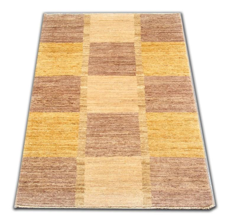 These Oriental carpets from Afghanistan have rich colors and abstract elements. This modern carpet gives a subtle contemporary appearance. This yellow rug is featuring a beautiful palette of gold and brown colors. This geometrical rug is grounded in