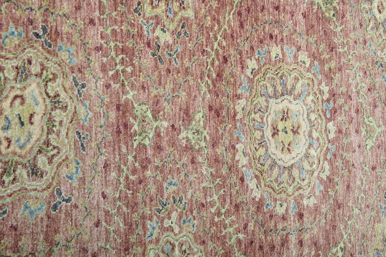 These carpet runners have a grand scale, regal colors and luxurious decorations. This antique Indian corridor carpet rug makes a bold statement in a chic manner. Kingly hues of burgundy, ivory, and glaucous blue are expertly worked together in this