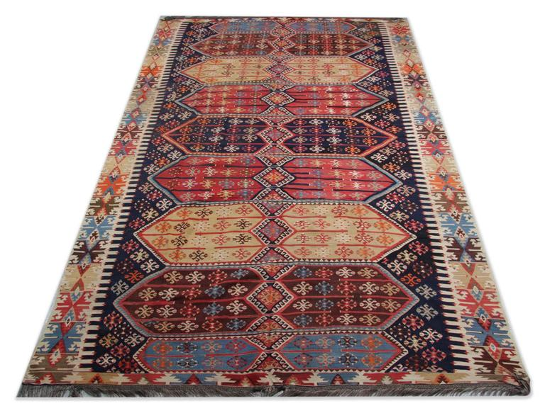 These Persian style rugs are from Konya, which is located in the heart of Turkey. The workshop kilim rugs of Konya are mostly known for their distinctive geometric designs. These patterned rugs have all over geometric design with the same patterns