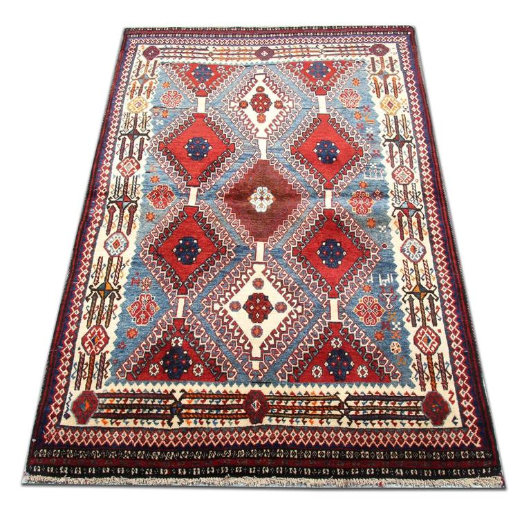 Yalameh is a town well known for the production of top-quality rugs with a unique diamond geometric rug designs. This is an example of new tribal rug made with 100% organic dyes and hand spun wool. These patterned rugs are grounded in stylish colors