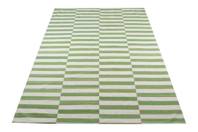 This striped rug is 100% handmade in Afghanistan. Kilim rugs are flat woven and the materials used for these luxury rugs are wool and cotton.  Only organic dyes were used for these handmade rugs. This green rug is hard-wearing and therefore will