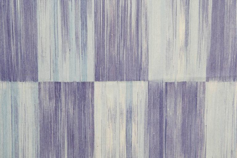This striped rug is 100% handmade in Afghanistan. These kilims are flat-woven handmade rugs. The traditional rugs materials are wool and cotton and the dyes are organic. This purple rug is hard-wearing and therefore will easily accommodate in any