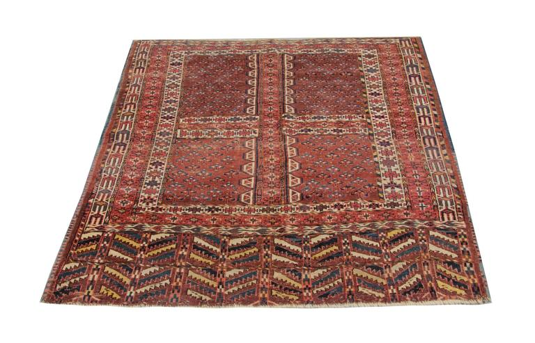 This is a beautiful hand-knotted Turkmen main tribal rug. Main patterned rugs are large rugs, regular Bukhara rugs are maximum 7 x 5 ft. This carpet rug is in excellent condition, with no restoration or repair previously done. This orange rug is one
