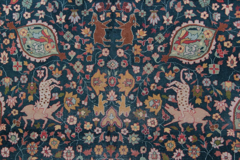 Antique Indian rugs from Agra in excellent original condition and a very interesting patterned rugs design. Woven with classic colors from this period of Indian weaving, using vivid natural green and gold. The animal print rugs are the wonderful