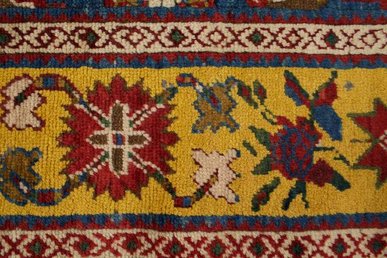 These antique rugs and runners are from the 1880s and they in excellent condition. This geometric rug has a four lozenge Persian rug designs in yellow, red, blue, green and cream. These colorful rugs would look beautifully as stair runners.