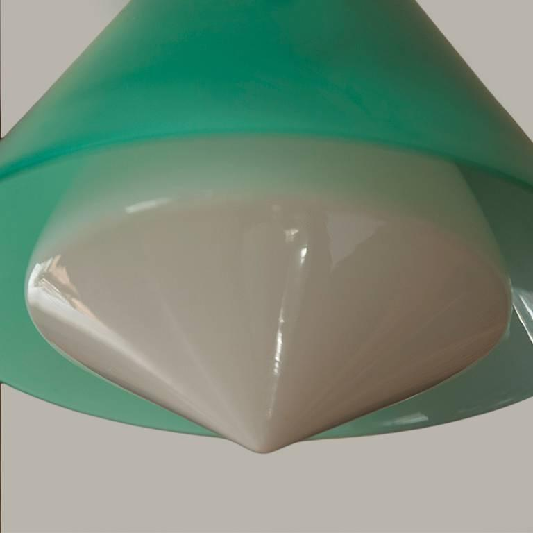 Glass pendant lamp by Peter Pelzel for Vistosi, Italy circa 1961, exterior shade in green glass with white glass interior diffuser, with hardware in brass and enameled metal. Manufactured by Vistosi, Murano.