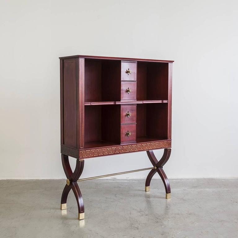 Rare and exceptional pair of four-drawer open cabinets on crossed-sabre legs by Osvaldo Borsani, in mahogany with brass detail and inlay, produced by Arredamenti Borsani Varedo, Italy, circa 1946