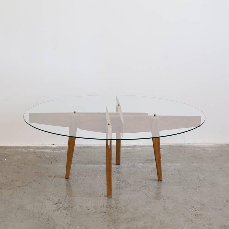 Coffee table by Gio Ponti, in oak with glass top and brass hardware, Italy, circa 1950s.