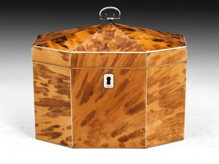 Exquisite blonde tented top tortoiseshell tea caddy with bone edges and stringing. The top features a beautiful sterling silver handle.