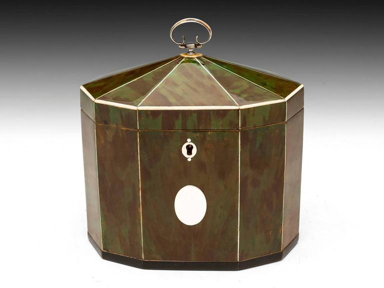 Rare decagonal tent top tea caddy with a deep green hue, separated by contrasting stringing. Horn lipped base, vacant silver initial plate, escutcheon, hinge and pull handle. The interior comprises two compartments with bone-handled green
