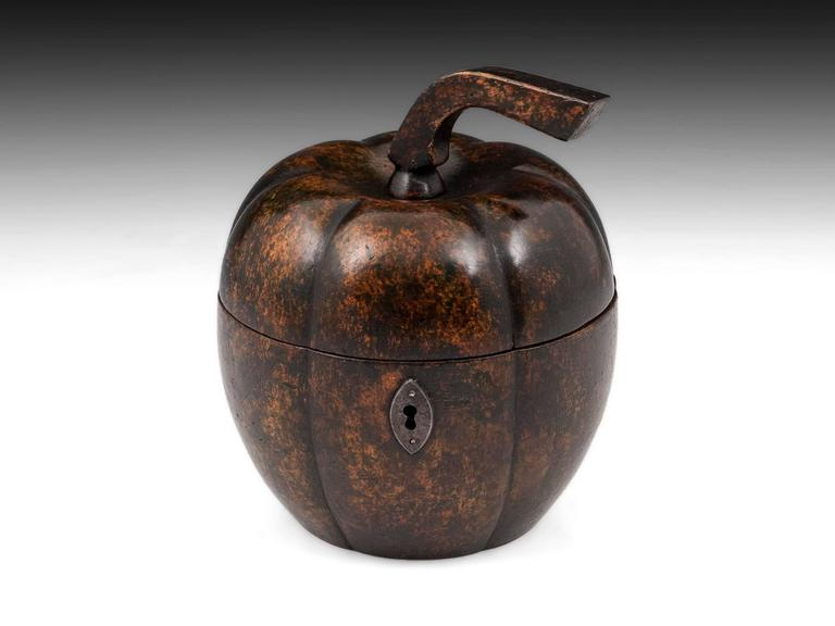 Extremely rare squash tea caddy with a beautiful dark mottled color, lovely patination, and has a wonderful original squared stalk only seen on this type of fruit tea caddy. Often mistaken for melons, it is the squared stalk that is the
