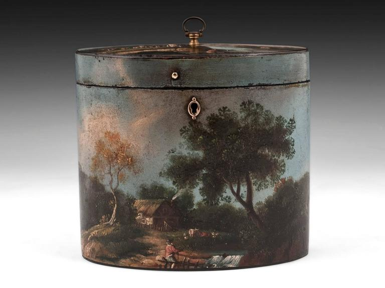 A beautifully painted papier mache Tea Caddy by Henry Clay. Decorated with quaint rural scenes. Scenes of a farmer and his herd, fishermen, and a group of boating folk are set against the backdrop of a beautiful blue sky. 