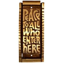 "Midcentury Bronze Door Knocker ""Peace to All Who Enter Here"", 1969"