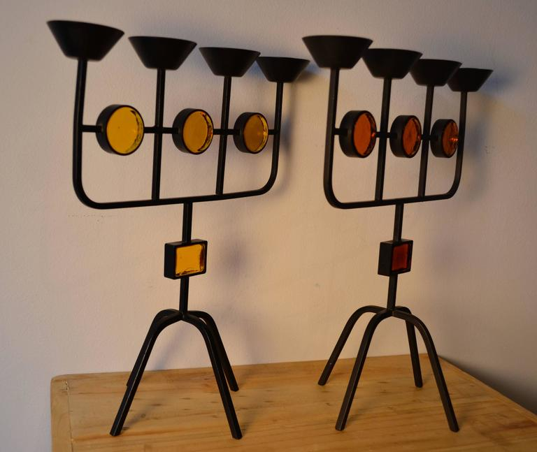 Beautiful pair of cast iron and yellow/orange art glass candlesticks designed by Erik Hoglund for Ystad Metal, Sweden, Mid-Century Modern, 1960s.