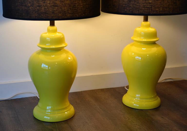 Pair of Mid-Century Modern vibrant yellow glazed ceramic ginger jar table lamps, 1960s.