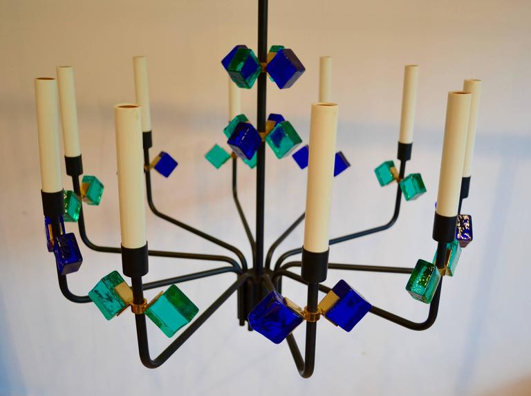 Rare and exceptional Danish chandelier by Svend Aage Holm Sorensen for Holm Sorensen and Company, Denmark, 1950. Gorgeous cobalt blue and aqua glass with brass detail and matte black metal frame. Ten lights.
