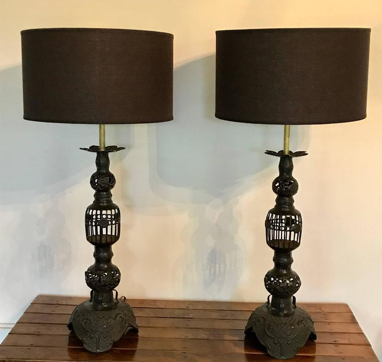 Impressive pair of Japanese candleholders made into table lamps in the mid-20th century. Recently re-wired including beautiful brass hardware. Shades not included.