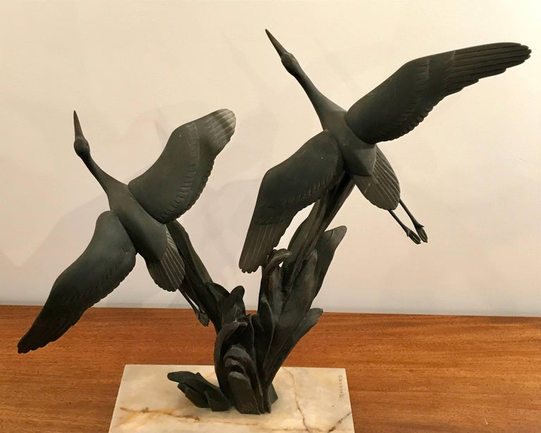 Beautiful Art Deco patina bronze sculpture of seagulls in flight by French sculptor Irenee Rochard (1906-1984) on a polished white and black marble base.