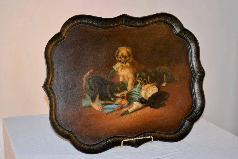 19th century papier mâché tray depicting three terrier puppies tearing apart a doll toy, hand-painted on a wonderful Gothic-shaped tray by B. Walton & Co. Benjamin Walton took over the running of the firm of Walton & Co. at Old Hall in Wolverhampton