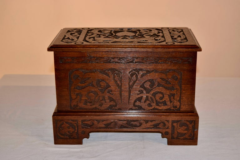 Late 19th century miniature blanket chest with lovely hand-carved decoration on three sides and the top has a carved heart. Great size.