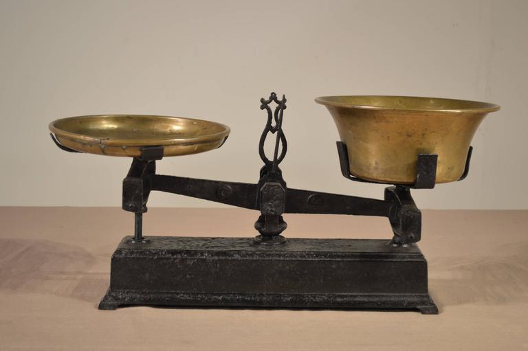 19th century French scale-made from iron with brass weighing bowls. Comes with four weights. Lovely size and proportion.