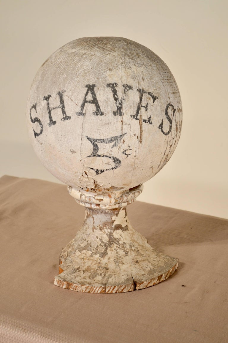 19th century American shaving advertisement sign. Wear and losses to paint.