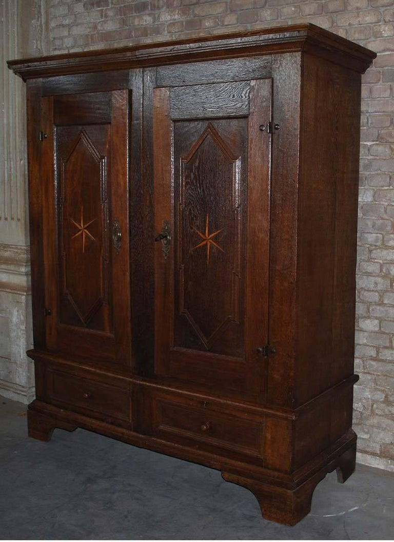 19th century oakwood cabinet. This cabinet has two doors and two drawers. Originates Germany, dating circa 1820.