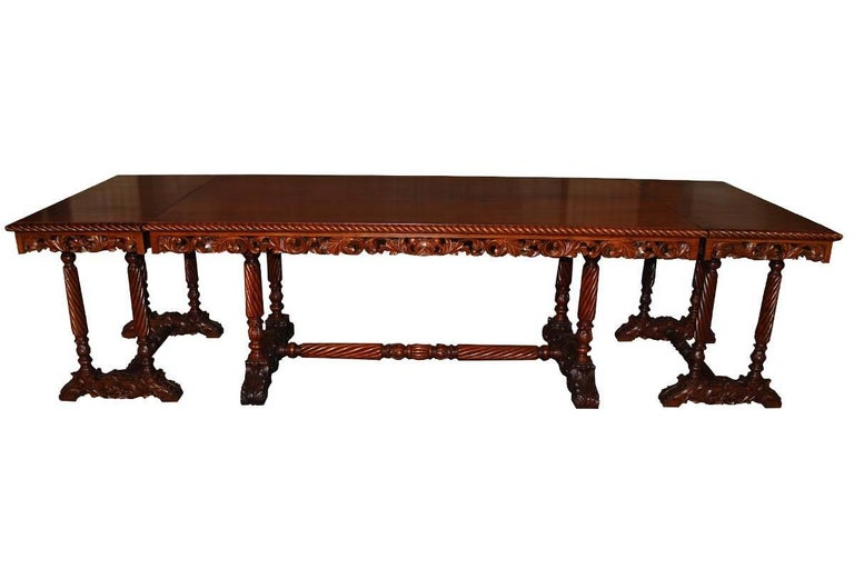 20th century. Neo Renaissance Italian hand-carved table with two matching sidetables which also can be used as extensions on each side of the table. The table and side tables / extensions are made from mahogany. The tabletop is made from 1 single