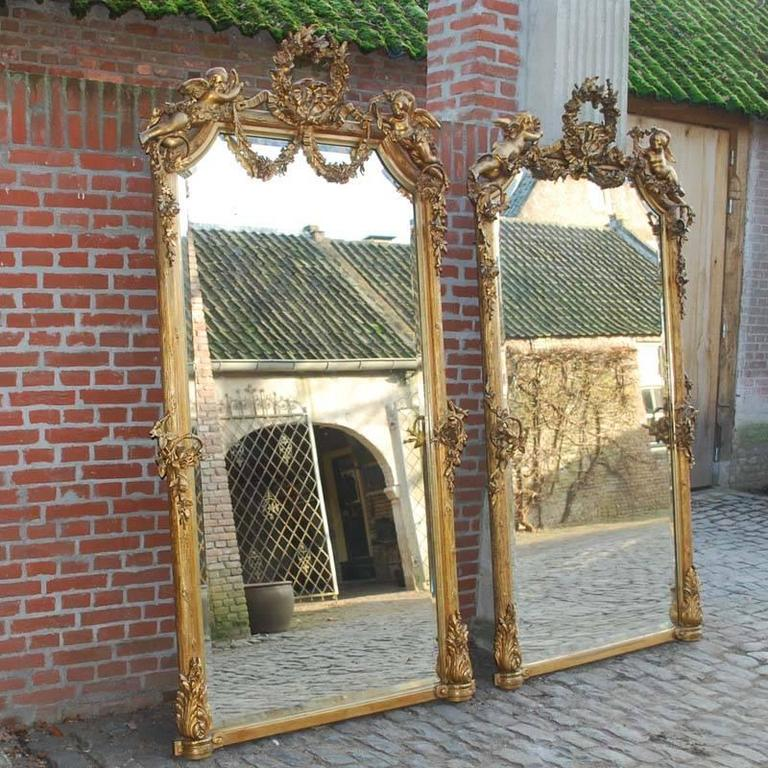 This astonishing pair of antique French mirrors is made in southern France around 1870.  They are well preserved and very much authentic. The glass has a facet edge and is the original plate in both mirrors.  The most elevated part of the frame is