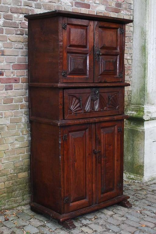19th century primitive chestnut wood cabinet handcrafted in Spain.