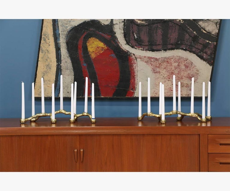 Pair of Mid-Century brutalist candelabras designed and manufactured in the United States circa 1970's. These brass-plated aluminum candelabras feature a raw and natural appearance with age appropriate patina that enhances its brutalist aesthetic.
