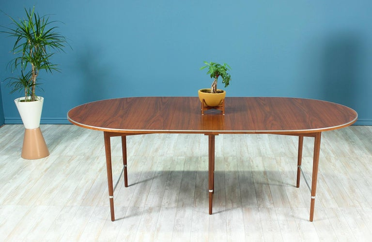 """Beautiful dining table designed by Paul McCobb for H. Sacks & Sons """"Connoisseur"""" line in the United States circa 1950's. A Mid-Century modern sleek design that shows the quality craftsmanship of designer Paul McCobb. This dining table features an"""