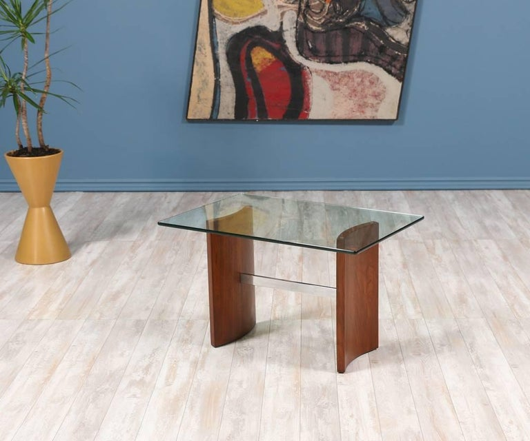 Mid-Century Modern Propeller side table designed by German-born architect and furniture designer, Vladimir Kagan, for Selig in the 1950's. Its clean and geometric lines represent Kagan's aesthetic. Made of a newly refinished walnut base connected by