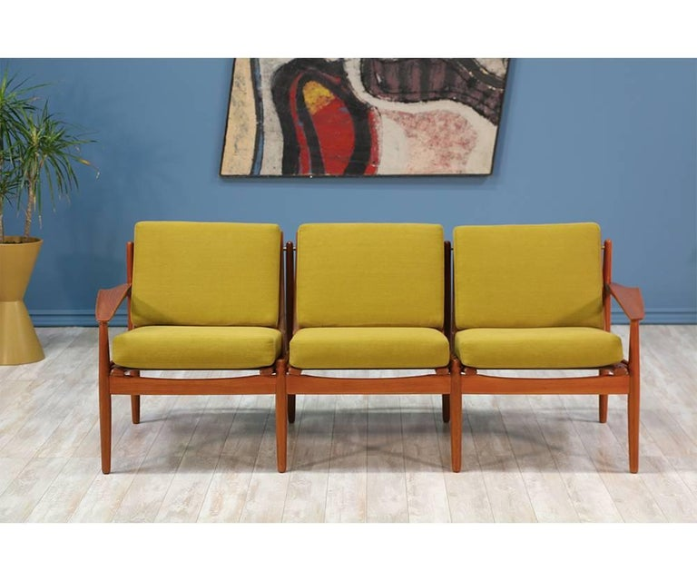 Three-seater sofa designed by Danish modernist, Svend Åge Eriksen, and manufactured in Denmark by Glostrup Møbelfabrik in the 1960's. Featuring a teak wood frame with beautiful grain and reupholstered high density foam cushions in a new vibrant