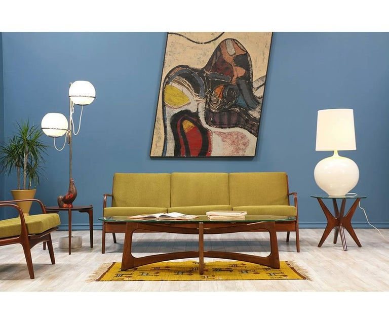 Mid Century Modern sofa designed by Adrian Pearsall for Craft Associates in the United States c. 1960's. Features a walnut wood solid frame adorned with tapered spindles on the back rest and sculptural legs representative of Pearsall's style.