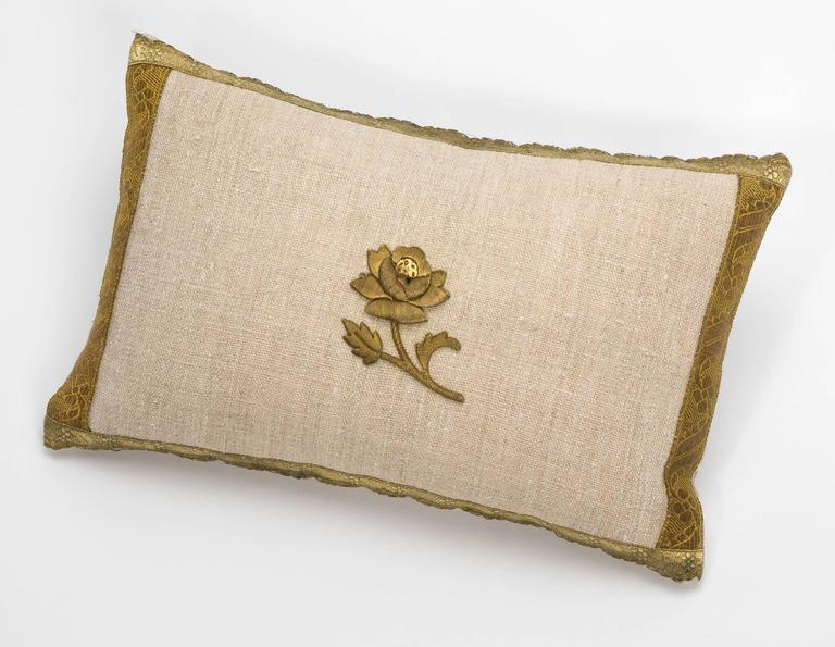 Newly made, vintage linen pillow with 19th century metallic gold thread rose appliqué. Bordered with antique gold trims. Plain linen back. Filled with new feather down insert.