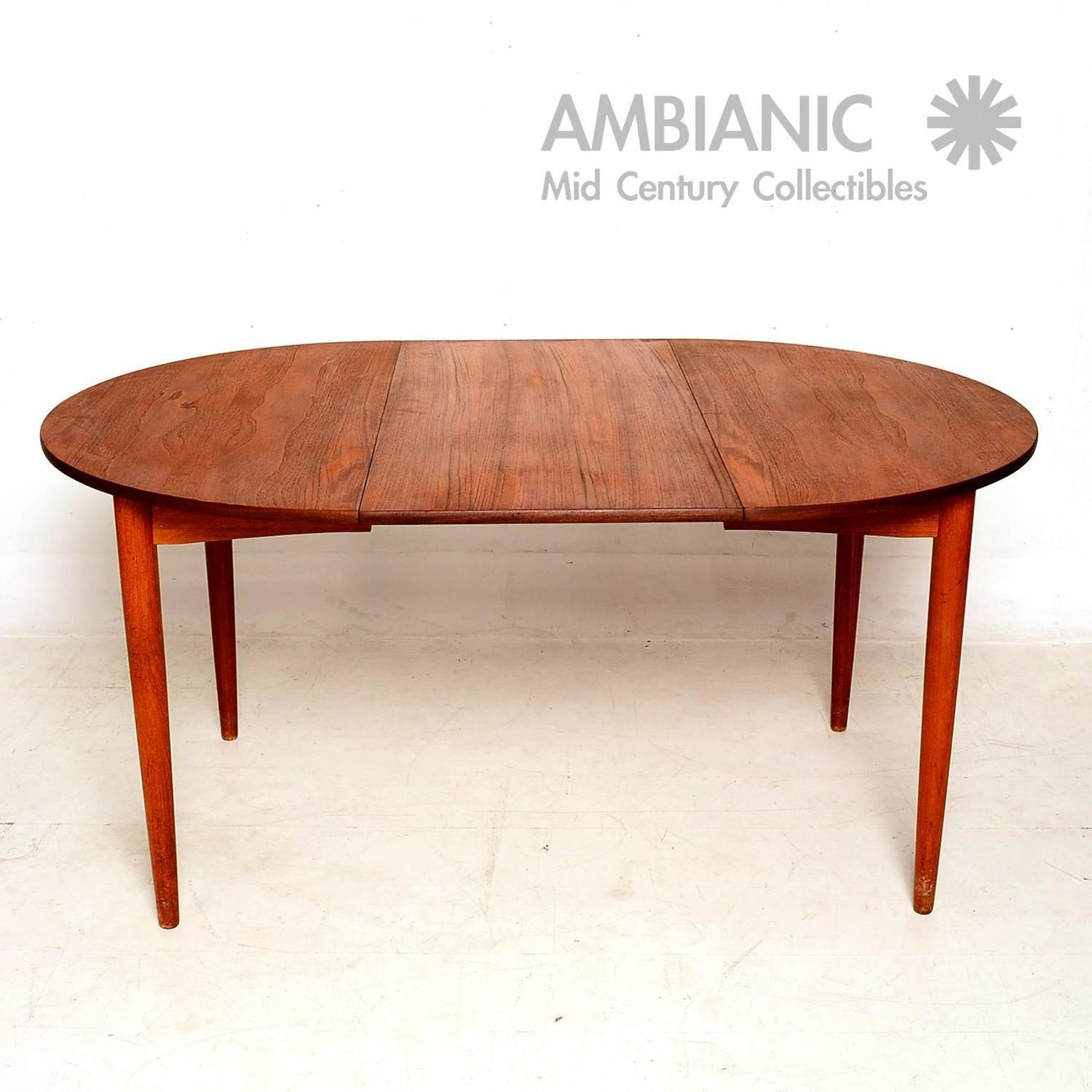 Danish modern teak round oval dining table for sale at 1stdibs for Oval dining table