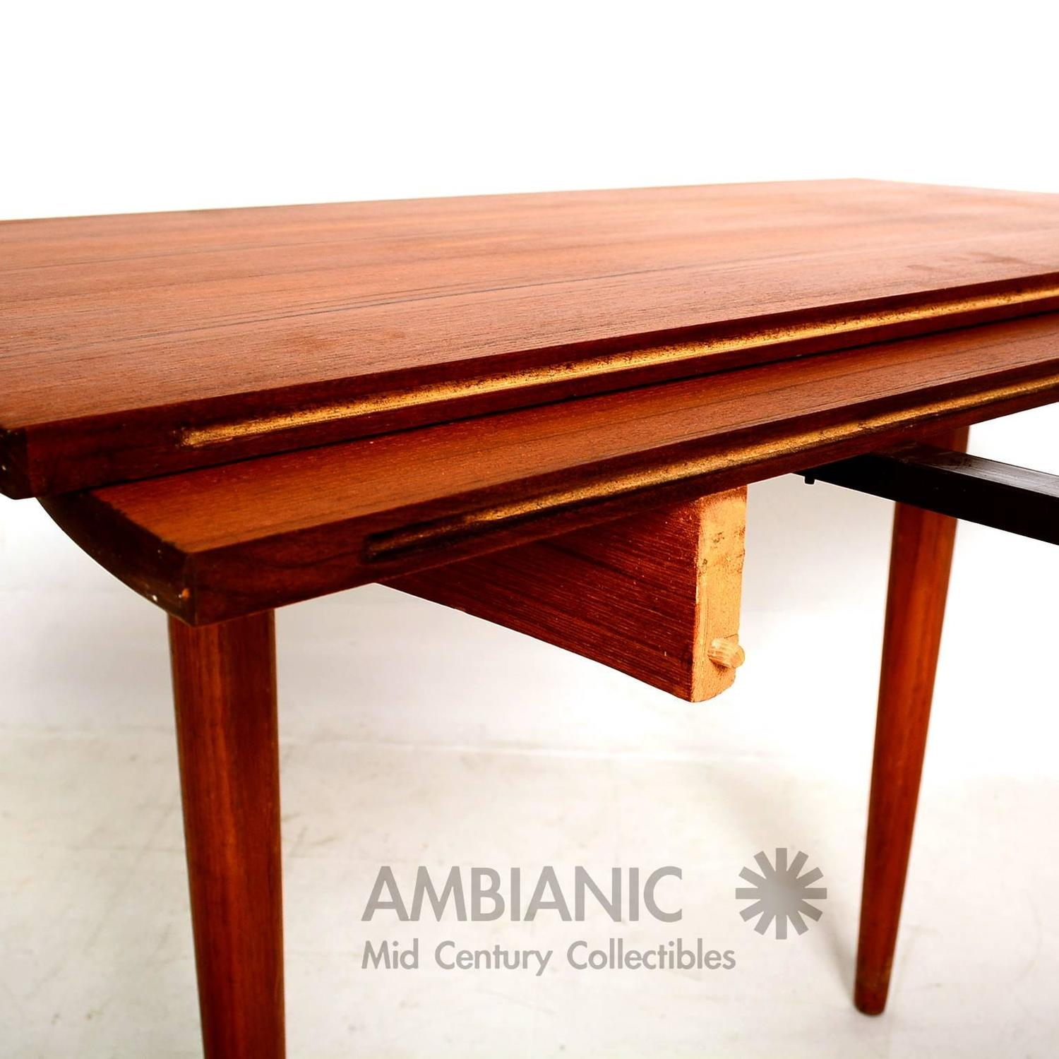 Danish modern teak round oval dining table for sale at 1stdibs for Modern oval dining room table