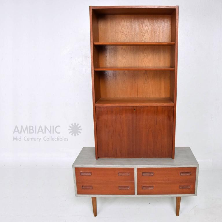 For your consideration a Danish modern cabinet with four pull-out drawers and hutch. The cabinet is two-tone, teak with grey cerused finish. Cabinet mounted in solid teak peg legs. Retains Danish control label in one side of the drawer. All