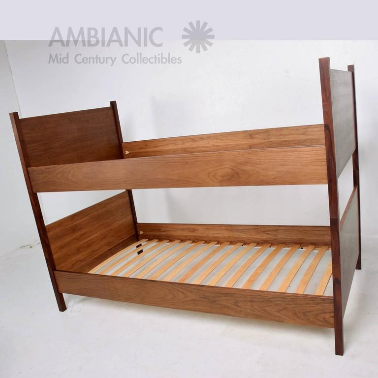 For your consideration a walnut and rosewood bunkbeds. They can break apart with ease for safe and easy shipping. Will fit a stands twin size mattress (Not included).  Current production 6 to 8 weeks lead time. Made in the USA.  Measures: 56
