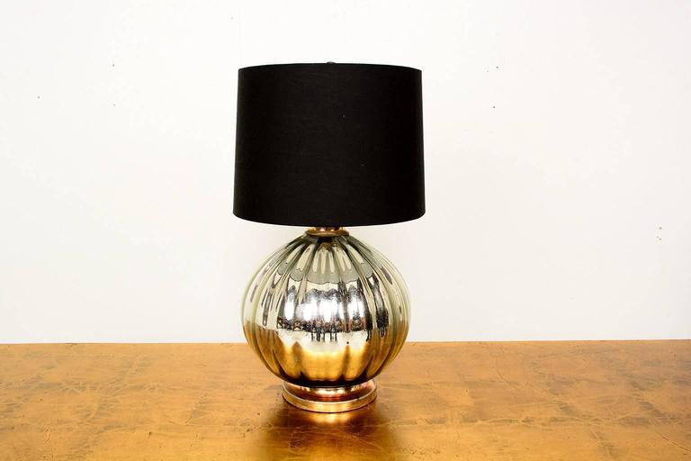 For your consideration a mercury table lamp, mounted in a metal base.  The lamp has been rewired.   Black shade is not included in the sale, for props only, however we can source one for an additional fee.   Mexico, circa 1950s, Unmarked.