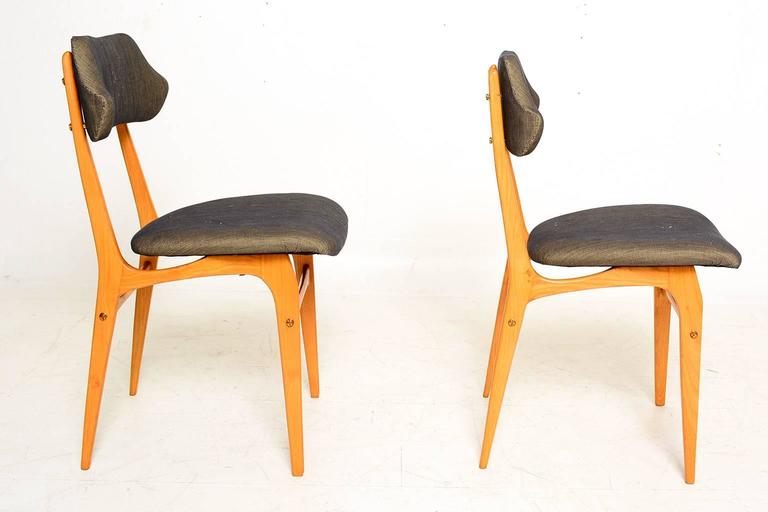 For your consideration a pair of Italian side chairs in the manner of Carlo Mollino.  Beautiful sculptural shape. Blond wood. New upholstery. Very comfortable.