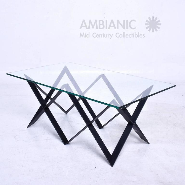 For your consideration a vintage coffee table in iron painted in black with a glass top,