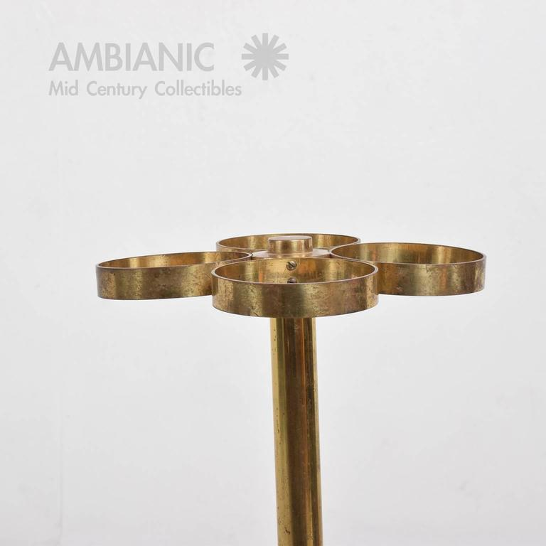 For your consideration a vintage Mid-Century Modern umbrella or cane stand. Cast iron base with original paint and brass body/rings.  The iron base has the original colors. 13 3/8