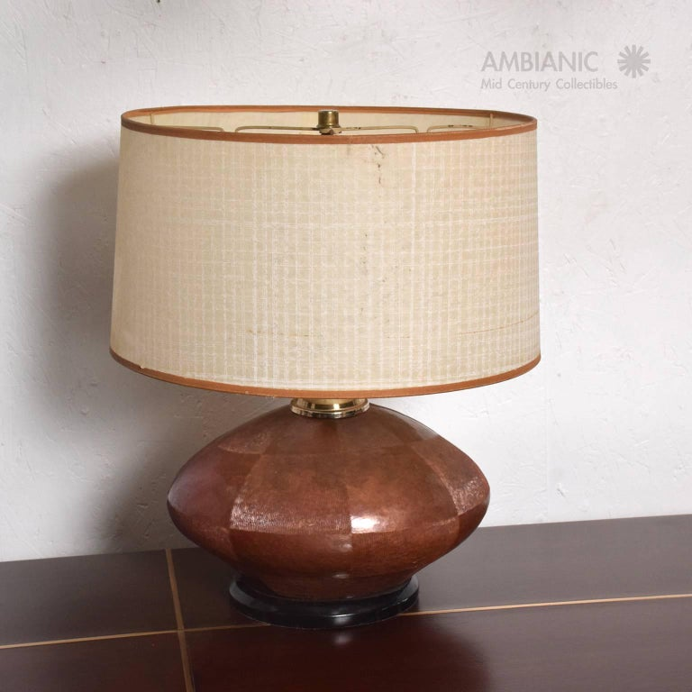 For your consideration a unique table lamp with a texturized and patinated cooper body mounted in a wood base (painted in black) and brass hardware.   Lamp has been tested and currently working. Lampshade not included. Lamp has the original